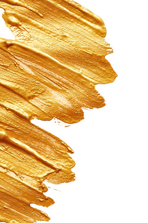 Strokes of golden paint isolated on white background Banque d'images