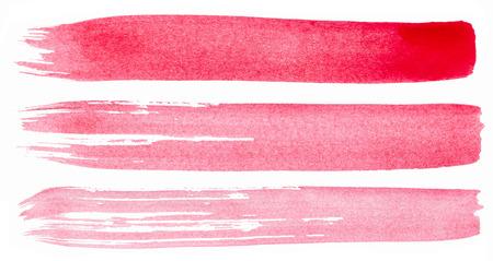 Slagen van roze verf op een witte achtergrond Stockfoto