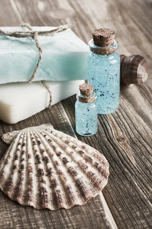 spa still life: Spa still life with seashells on wooden background Stock Photo