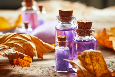 Purple Spa still life with autumn leaves on wooden background Archivio Fotografico