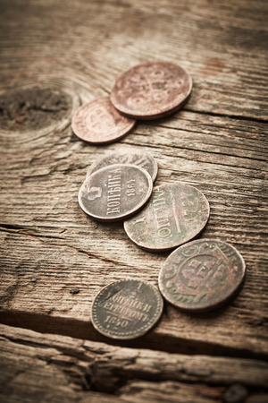 old coins: Old coins on wooden background