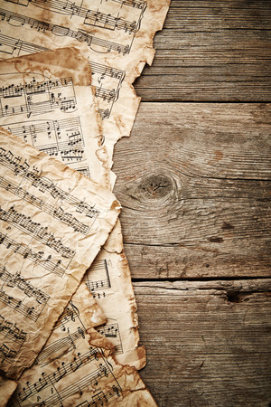 octaves: Vintage music sheets on wooden background