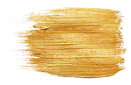 Slagen van gouden verf op een witte achtergrond Stockfoto