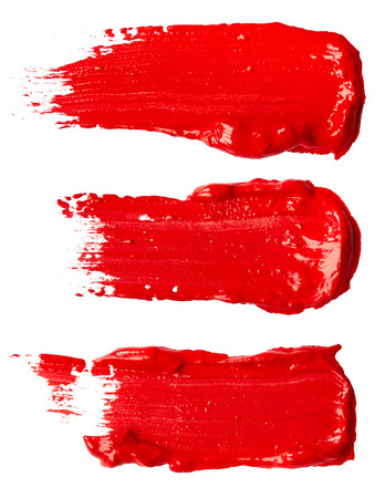 Strokes of red paint isolated on white background