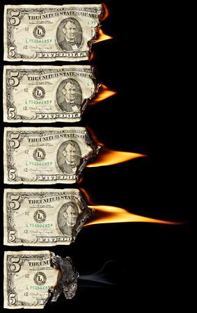 arsonist: Burning dollars on black background