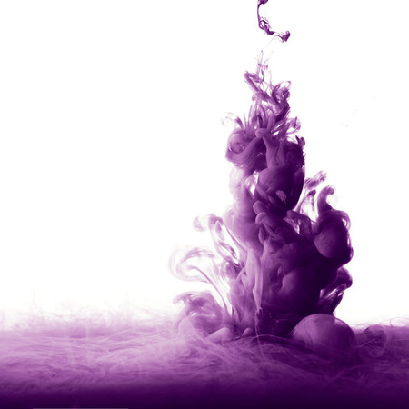 Abstract splash of purple paint isolated on white background