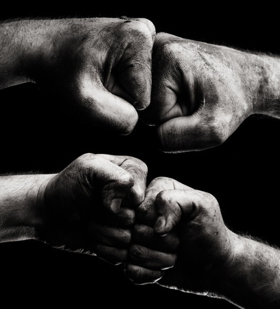 clenched: Resistance. Dirty male clenched fist Stock Photo
