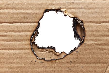 burnt: Burnt hole in cardboard