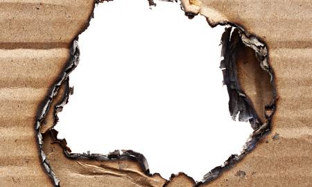burnt: Burnt hole of cardboard Stock Photo