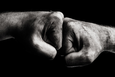 clenched fist: Resistance. Dirty male clenched fist Stock Photo