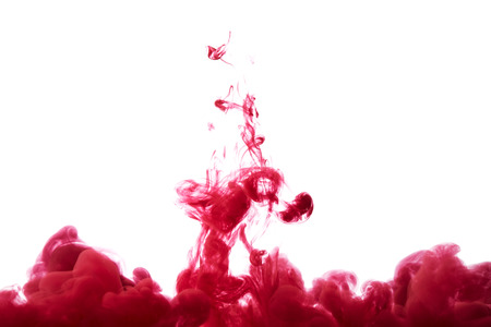 Abstract splash of red paint isolated on white background