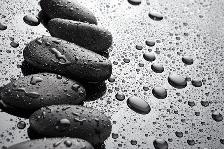 black stones: Stones on black background with drops of water Stock Photo