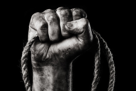 clenched fist: Rope in male hand. Danger Stock Photo
