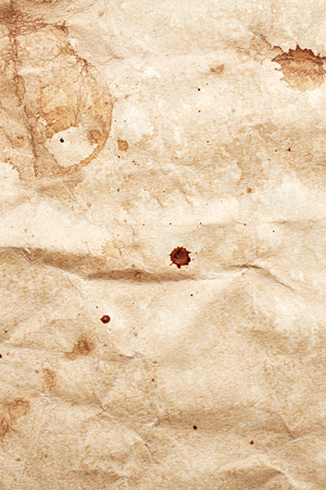 stain: Texture of paper with blots of coffee