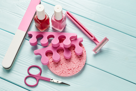 manicure and pedicure: Pedicure set on wooden background