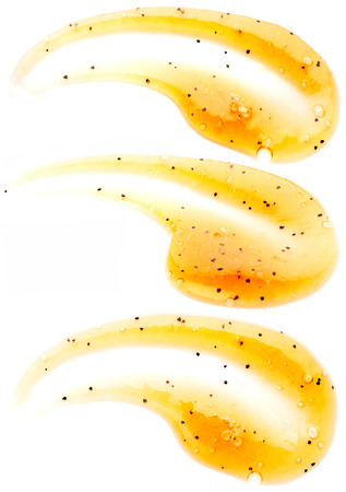 with orange and white body: Orange body scrub isolated on white background
