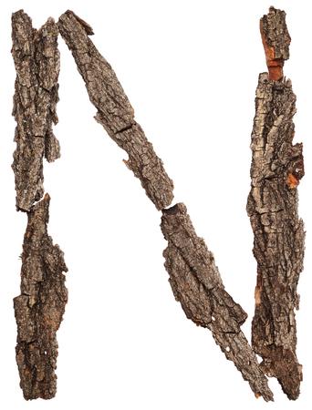 english oak: Alphabet from bark tree isolated on white background. Letter N