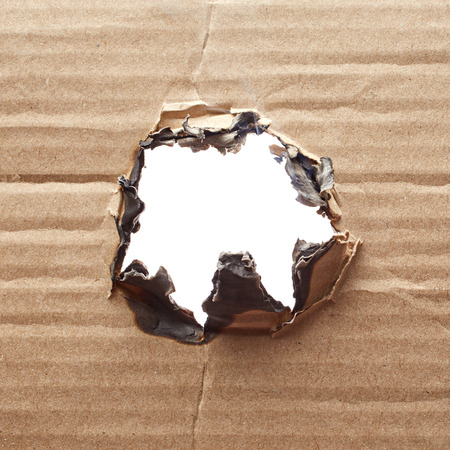 burnt: Burnt hole in cardboard