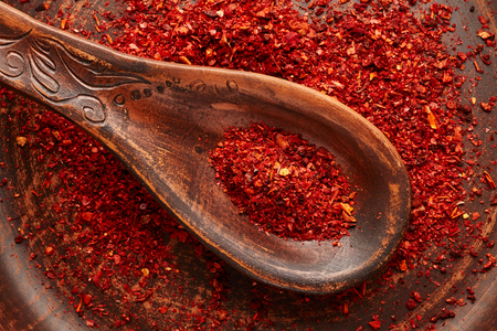 red pepper: Red pepper spice on vintage plate Stock Photo