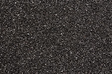 黒い石の背景を抽象化します。黒の砂のテクスチャ 写真素材