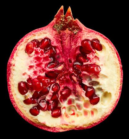 garnets: Pomegranate on black background