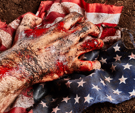 Male hand of hero protect american flag over soil background Stock Photo