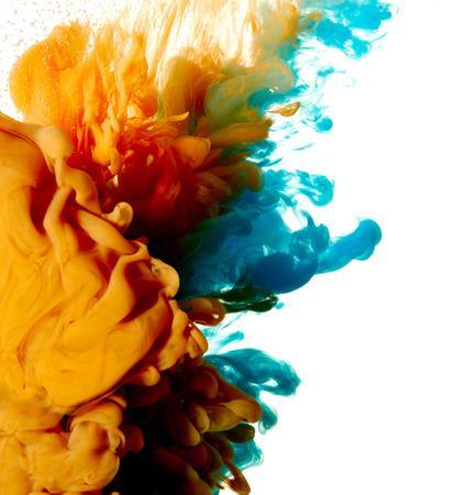 Abstract blue and orange paint splash isolated on white background Stock Photo