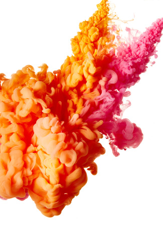 Abstract splash of pink and orange paint isolated on white background