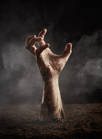 dirt background: Hand of zombie in dirt