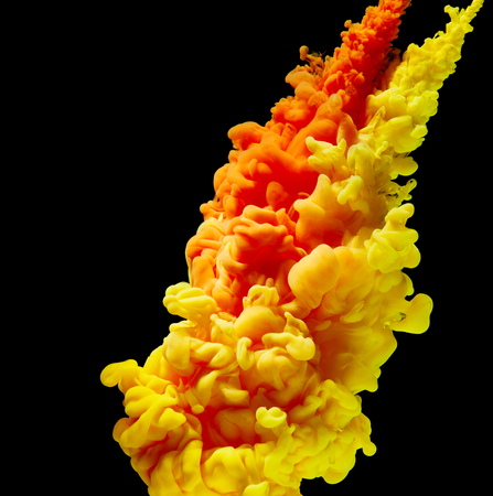 splash abstract: Splash of yellow and red paint isolated on black background Stock Photo