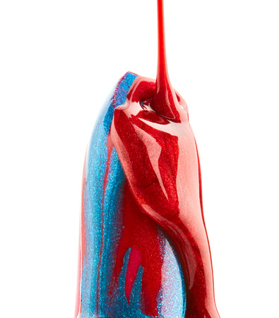 Nail polish on red lipstick isolated on white background