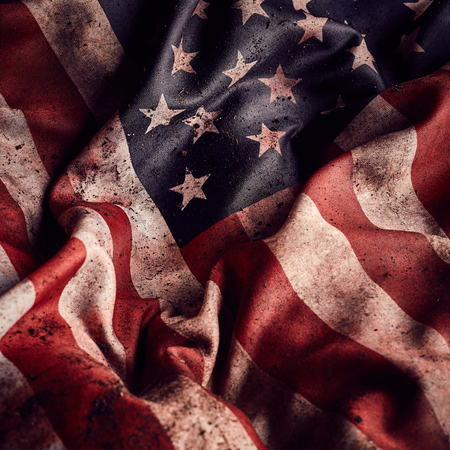 creased: Grunge creased american flag background with dirt and blood