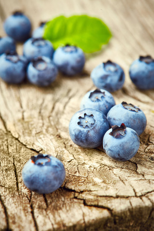 wildberry: Fresh blueberries on wooden background Stock Photo