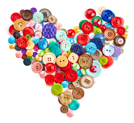 Sewing buttons heart isolated on white background