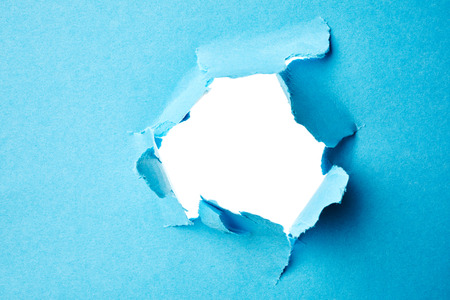 white hole: White hole in paper. Abstract background Stock Photo