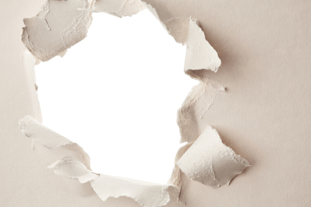 white hole: White hole in the paper. Abstract background