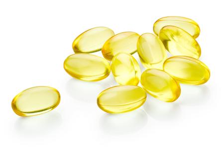Vitamine E capsules geïsoleerd op een witte achtergrond Stockfoto