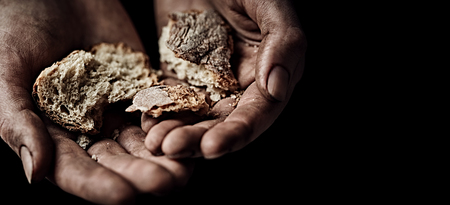 Poverty concept. Hands with rusks Stock Photo