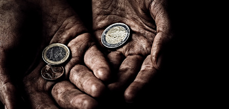 disadvantaged: Beggar hands with few coins. Poverty concept