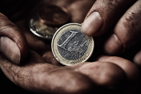 Poverty concept. Hands with coin close up Stock Photo