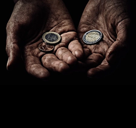 Poverty concept. Hands with few coins