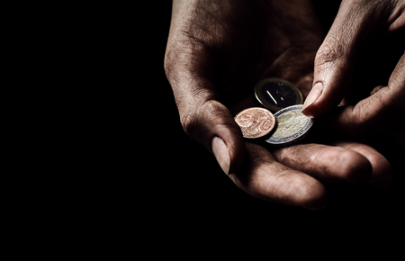 disadvantaged: Poverty concept. Dirty hands with few coins