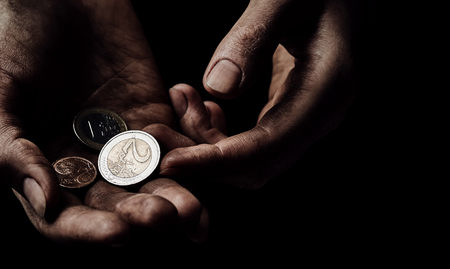 disadvantaged: Hands of beggar with few coins. Poverty concept