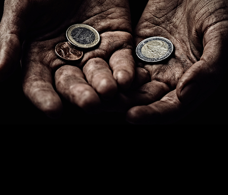 Poverty concept. Old beggar hands with few coins Stock Photo