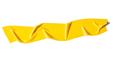 Yellow adhesive tape isolated on white background