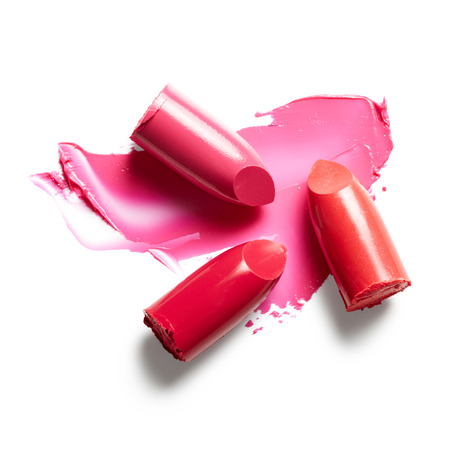 Lipsticks and lipstick smear isolated on white background