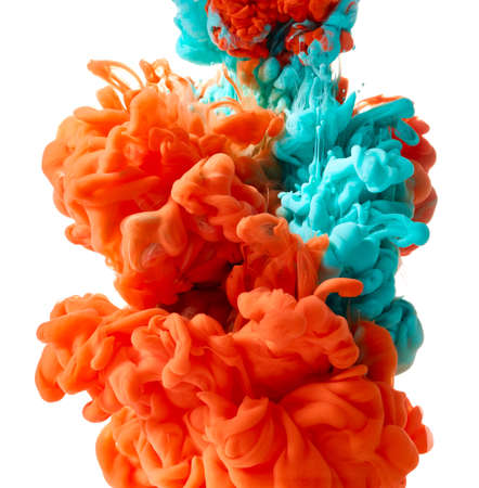 Blue and orange ink drop on white background