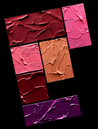 Set of textured lipstick swatches in red, pink, purple and beige colors over black background