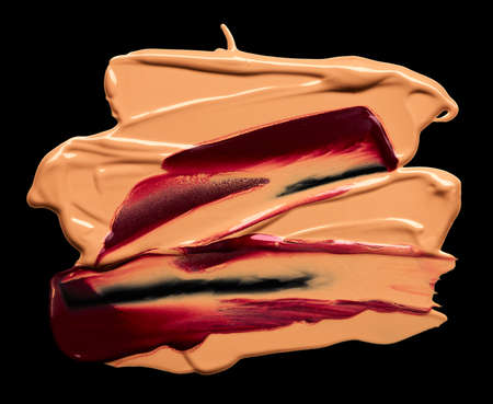 Smudged makeup foundation and lipstick isolated on black background Standard-Bild
