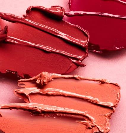 Lipstick smears over pink background Standard-Bild